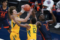 Baylor's Matthew Mayer (24) takes the rebound away from Illinois' Kofi Cockburn (21) as Butler's Jared Butler (12) watches during the second half of an NCAA college basketball game Wednesday, Dec. 2, 2020, in Indianapolis. (AP Photo/Darron Cummings)