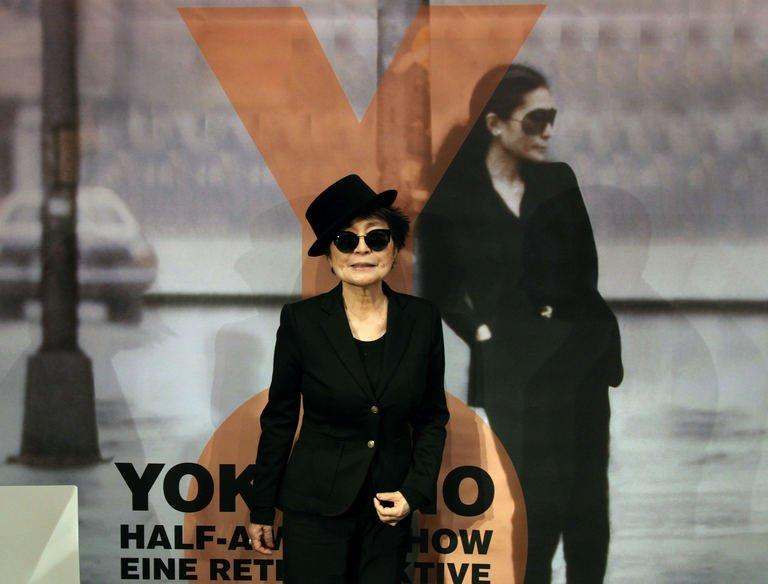 "Yoko Ono poses during the opening of her exhibition ""half-a-wind show"" at the Schirn Kunsthalle in Frankfurt am Main, central Germany on February 14, 2013. The largest-ever retrospective of works of Yoko Ono, once described by her late husband John Lennon as ""the most famous unknown artist in the world"", opened in Frankfurt's Schirn Kunsthalle"