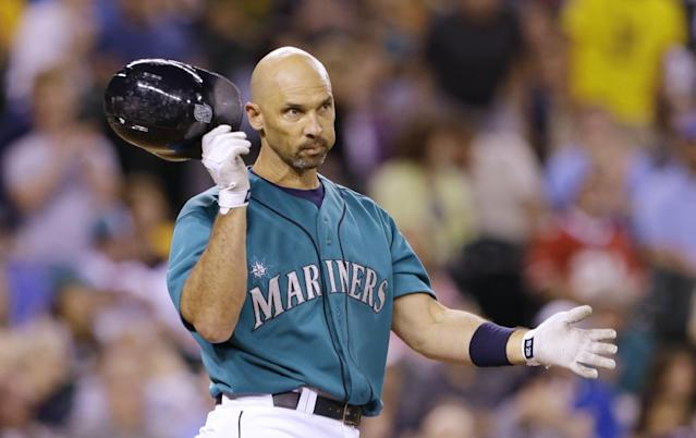 Seattle Mariners' Raul Ibanez pulls off his batting helmet after striking out against the Minnesota Twins to end the 10th inning of a baseball game Friday, July 26, 2013, in Seattle. The Twins and Mariners are tied 1-1 after 10 innings. (AP Photo/Elaine Thompson)
