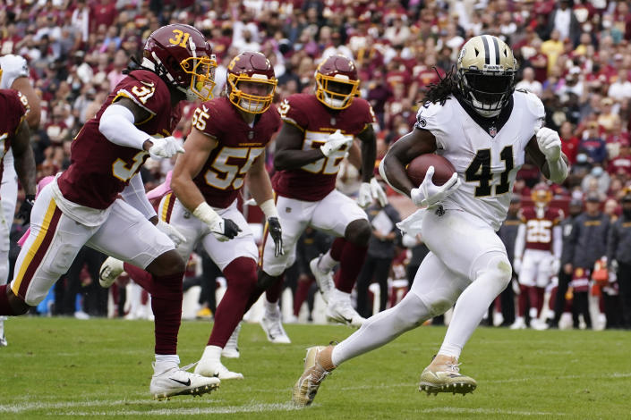 FILE - New Orleans Saints running back Alvin Kamara (41) rushes for a touchdown against the Washington Football Team in the first half of an NFL football game in Landover, Md., in this Sunday, Oct. 10, 2021, file photo. The Kansas City Chiefs and Washington head into their matchup this weekend as two of the worst defenses in the NFL. No teams have allowed more points this season and they're both coming off allowing 30-plus points last week.(AP Photo/Alex Brandon, File)