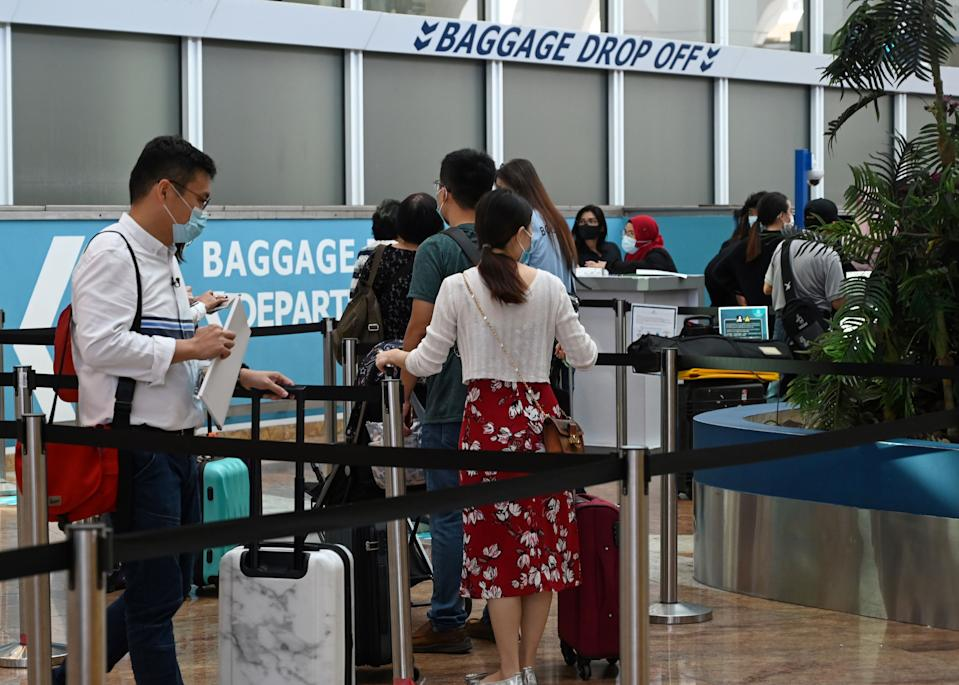 Passengers at the departure area at Marina Bay Cruise Centre in Singapore.