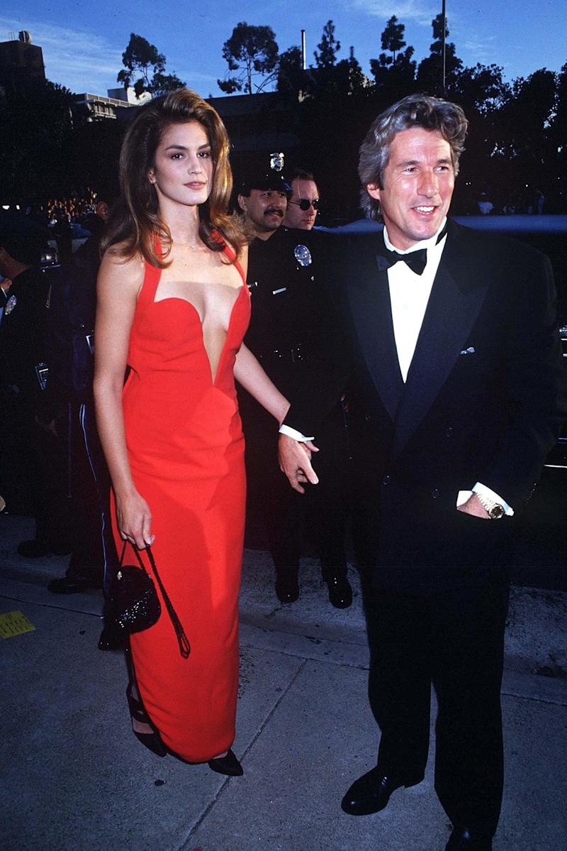 The plunge neck and pop of colour with a tiny bag may have been worn by Cindy Crawford in 1991 but it would still look fitting now - Timeless inspo from the supermodel era.