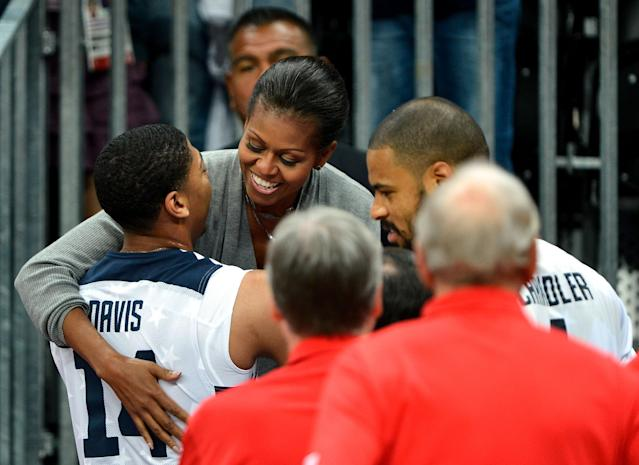 LONDON, ENGLAND - JULY 29: First Lady Michelle Obama of the United States hugs Anthony Davis #14 of United States after winning their the Men's Basketball game against France on Day 2 of the London 2012 Olympic Games at the Basketball Arena on July 29, 2012 in London, England. (Photo by Pascal Le Segretain/Getty Images)