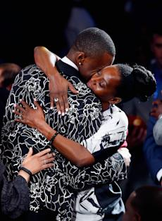 Andrew Wiggins hugs his mother after being drafted. (Getty)