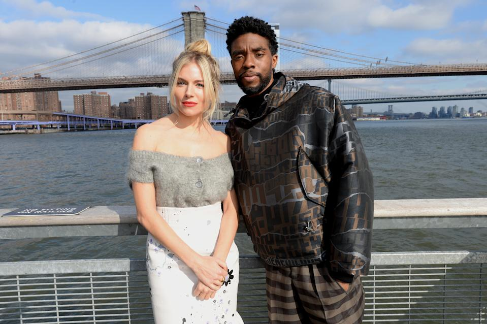 """NEW YORK, NEW YORK - NOVEMBER 19: Sienna Miller(L) and Chadwick Boseman poses during a photo call for """"21 Bridges"""" at The Fulton on November 19, 2019 in New York City. (Photo by Brad Barket/Getty Images for STXfilms)"""