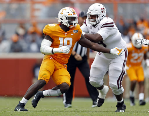 FILE - In this Oct. 12, 2019, file photo, Tennessee linebacker Darrell Taylor (19) plays against Mississippi State in the second half of an NCAA college football game in Knoxville, Tenn. Taylor was selected by the Seattle Seahawks in the second round of the NFL football draft Friday, April 24, 2020. (AP Photo/Wade Payne, File)