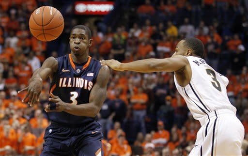 Illinois' Brandon Paul, left, passes the ball as Missouri's Matt Pressey defends during the first half of an NCAA college basketball game Thursday, Dec. 22, 2011, in St. Louis. (AP Photo/Jeff Roberson)