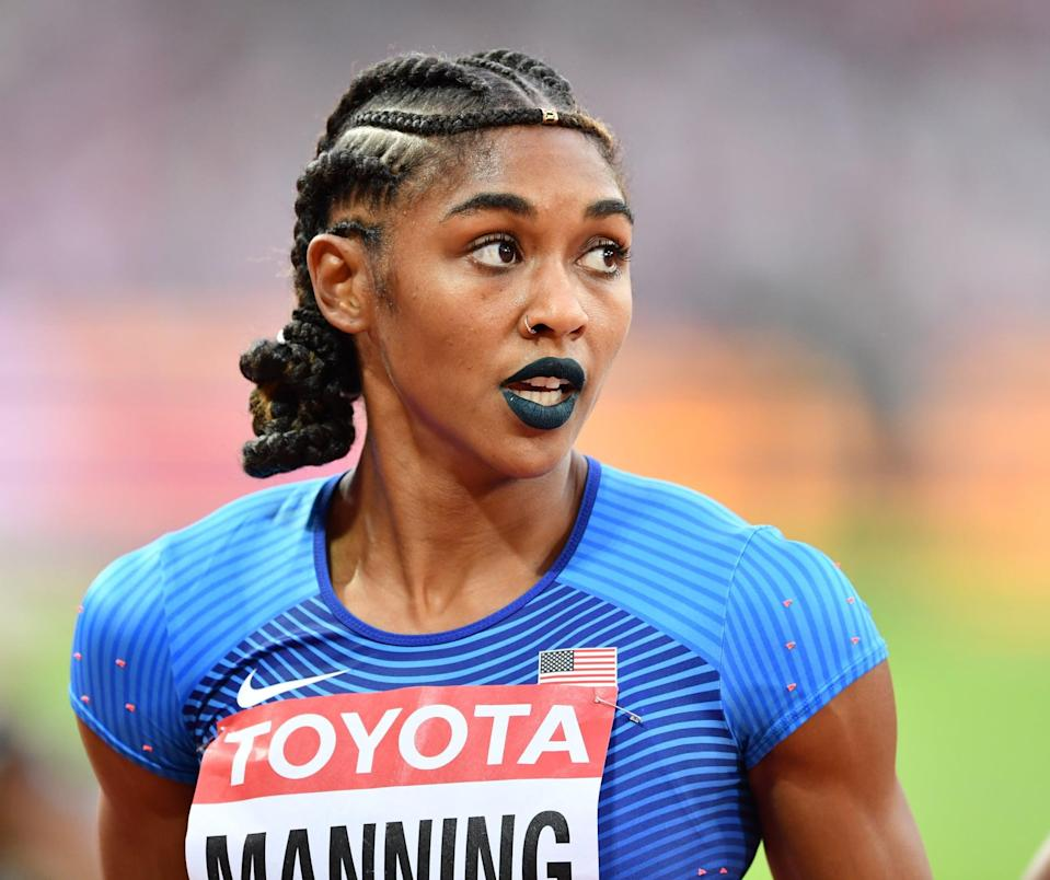 <p>Wearing blue lipstick and a braided crown-like bun hairstyle at the 2017 IAAF World Championships in London.</p>