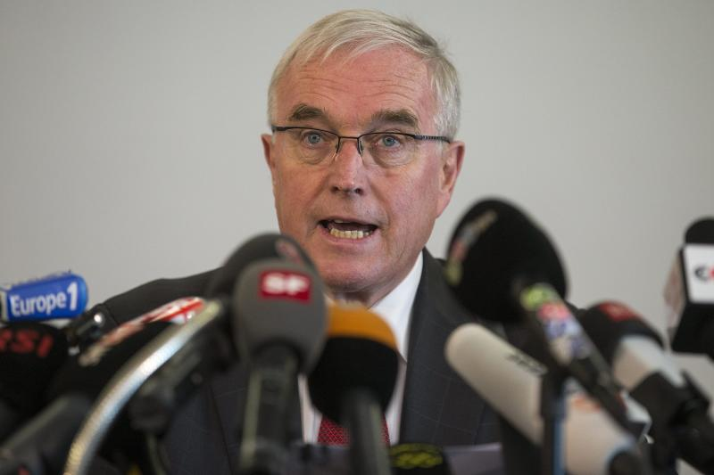 FILE - In this Monday, Oct. 22, 2012 file photo, Pat McQuaid, President of the Union Cycliste Internationale, UCI, talks during a press conference in Geneva, Switzerland. British Cycling president Brian Cookson has called a news conference for Tuesday June 4, 2013 amid speculation he will challenge Pat McQuaid for the presidency of world governing body UCI. (AP Photo/Keystone, Salvatore Di Nolfi, File)