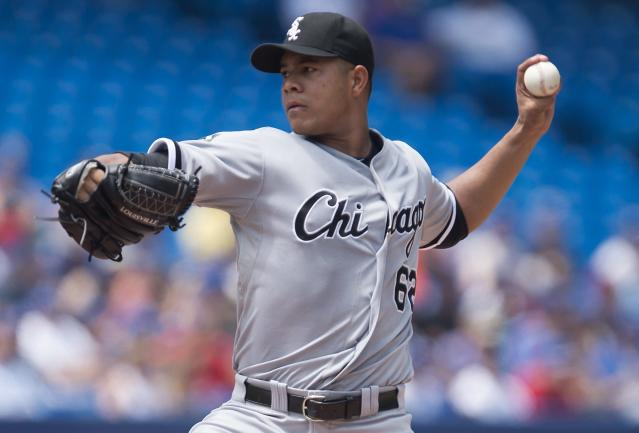Chicago White Sox starting pitcher Jose Quintana works against the Toronto Blue Jays during the first inning of a baseball game in Toronto on Sunday, June 29, 2014. (AP Photo/The Canadian Press, Darren Calabrese)