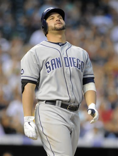 San Diego Padres' Yonder Alonso reacts to hitting a pop fly out against the Colorado Rockies during the eighth inning of a baseball game in Denver, Friday, June 29, 2012. (AP Photo/Jack Dempsey