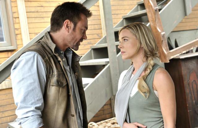 "Grant Bowler as Joshua Nolan and Julie Benz as Amanda Rosewater in the ""Defiance"" episode, ""Down in the Ground Where the Dead Men Go."""