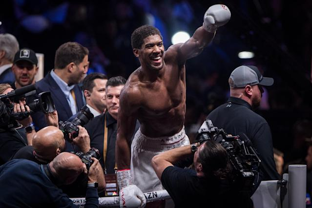 Anthony Joshua celebrates defeating Andy Ruiz Jr. (not pictured) in their heavyweight title fight at the Diriyah Arena. (Photo by Oliver Weiken/picture alliance via Getty Images)