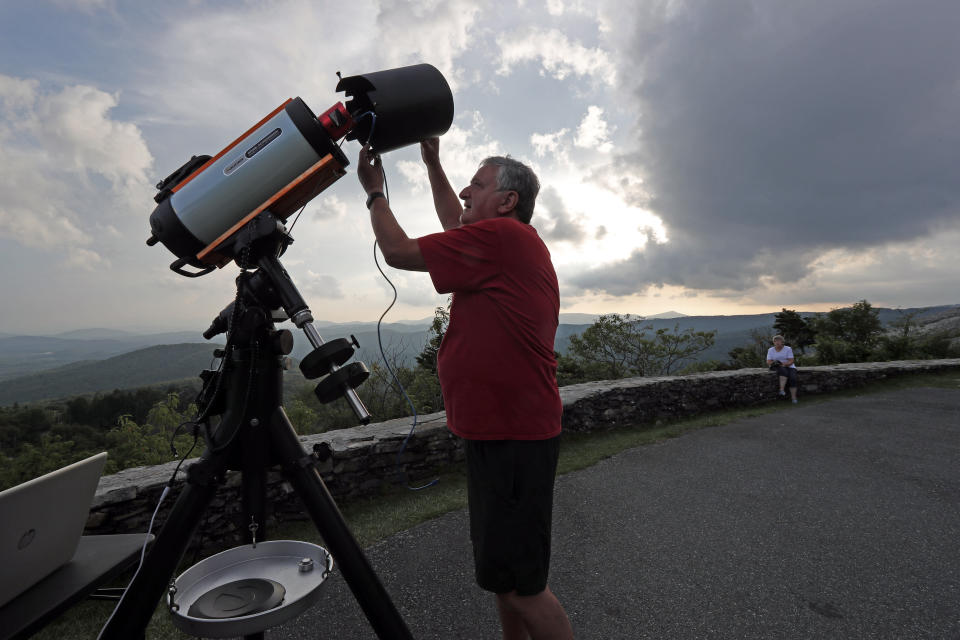 Astrophotographer Johnny Horne sets up his Celestron telescope to photograph Comet NEOWISE at Grandfather Mountain in Linville, N.C., Friday, July 17, 2020. (AP Photo/Gerry Broome)