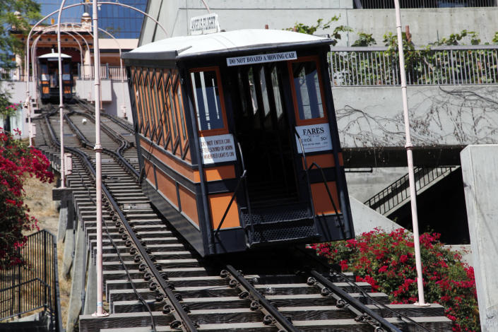 A trolly car rests derailed on the tracks of Angels Flight in downtown Los Angeles Thursday, Sept 5, 2013. An accident has stopped Angels Flight, the tiny funicular railway that goes up and down a hill in downtown Los Angeles. Fire Department spokeswoman Katherine Main says one of the two rail cars came off its tracks late Thursday morning. (AP Photo/Nick Ut)