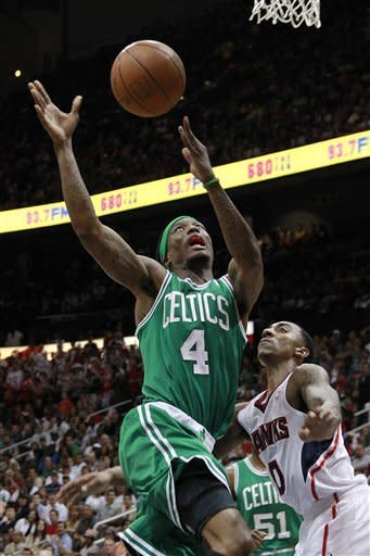 Boston Celtics guard Marquis Daniels (4) is fouled by Atlanta Hawks guard Jeff Teague (0) as he goes to the basket in the second half of Game 2 of an NBA first-round playoff basketball series Tuesday, May 1, 2012, in Atlanta. Boston won 87-80 and evened the series at one game each. (AP Photo/John Bazemore)