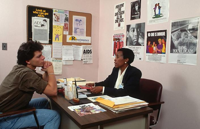 """<span class=""""caption"""">AIDS prevention counseling centers advised at-risk populations in New York in the 1980s.</span> <span class=""""attribution""""><a class=""""link rapid-noclick-resp"""" href=""""https://www.gettyimages.com/detail/news-photo/young-man-is-photographed-receiving-aids-prevention-news-photo/174525968"""" rel=""""nofollow noopener"""" target=""""_blank"""" data-ylk=""""slk:Yvonne Hemsey/Getty Images"""">Yvonne Hemsey/Getty Images</a></span>"""