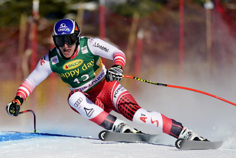 Matthias Mayer, of Austria, moves down the course during the men's World Cup downhill ski race in Lake Louise, Alberta, Sunday, Dec. 1, 2019. (Frank Gunn/The Canadian Press via AP)