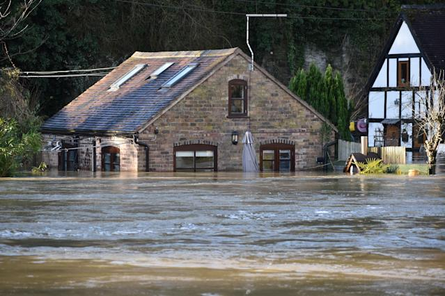 Flood barriers which have moved due to the weight of water in the River Severn in the Wharfage area of Ironbridge, Shropshire (PA)