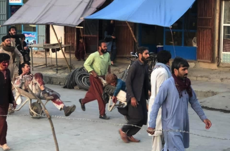 Two injured people are escorted away from the scene in wheelbarrows. Source: Twitter