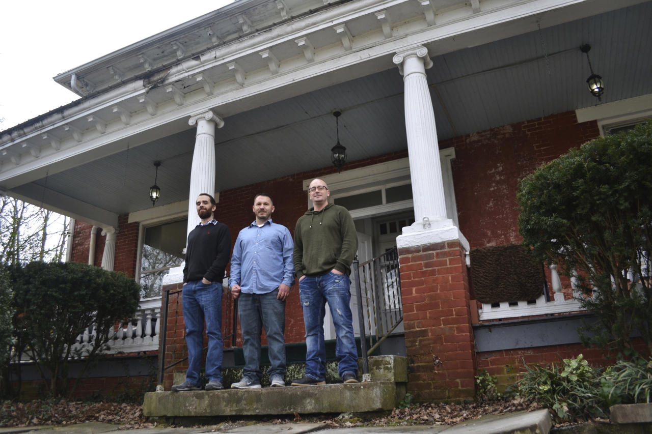 In this Feb. 1, 2017 photo, Tyler Witten, from left, John Holbrook and Jason Stone stand on the steps of the Sanibel House in Catlettsburg, Ky. The three men have gone through residential treatment programs operated by Addiction Recovery Care, which is seeing many new patients who are covered under Kentucky's Medicaid expansion as part of the Affordable Care Act. (AP Photo/Dylan Lovan)