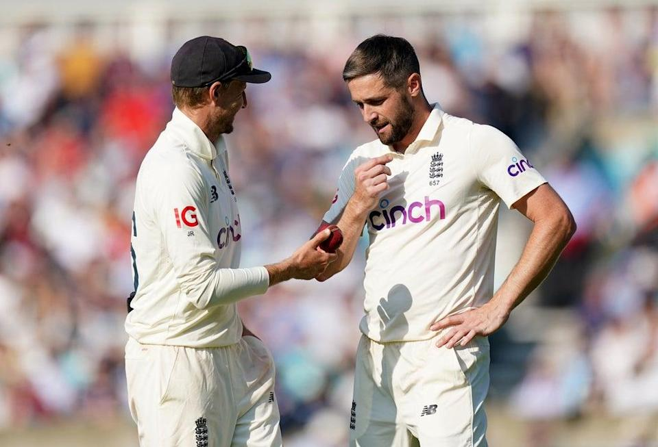 Chris Woakes, right, with captain Joe Root (PA)