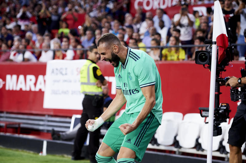 SEVILLE, SPAIN - SEPTEMBER 22: Karim Benzema of Real Madrid CF celebrates after scoring goal during the Liga match between Sevilla FC and Real Madrid CF at Estadio Ramon Sanchez Pizjuan on September 22, 2019 in Seville, Spain. (Photo by Aitor Alcalde/Getty Images)