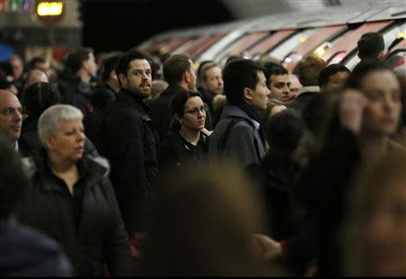 Commuters wait to board a Victoria line tube train during strikes at Kings Cross underground station in London February 6, 2014. REUTERS/Olivia Harris