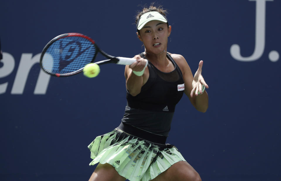 Qiang Wang, of China, returns to Ashleigh Barty, of Australia, during round four of the US Open tennis championships Sunday, Sept. 1, 2019, in New York. (AP Photo/Kevin Hagen)
