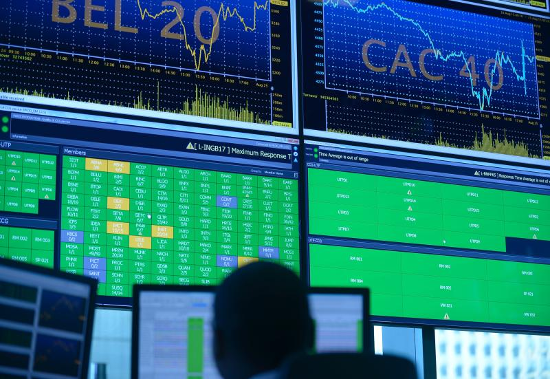 A photo taken on August 25, 2015 shows screens in the market services surveillance room center of European stock market operator Euronext's new headquarters in La Defense business district, near Paris. European stocks rebounded Tuesday in early deals, despite another rampant sell-off in China, as investors fished for bargain stocks after heavy losses the previous day. AFP PHOTO ERIC PIERMONT / AFP PHOTO / ERIC PIERMONT (Photo credit should read ERIC PIERMONT/AFP via Getty Images)