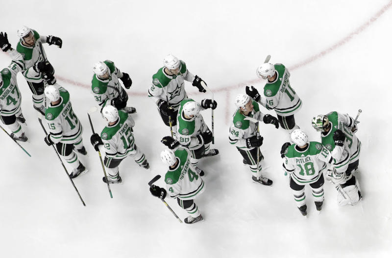 Dallas Stars players celebrate after defeating the Nashville Predators in Game 5 of an NHL hockey first-round playoff series Saturday, April 20, 2019, in Nashville, Tenn. (AP Photo/Mark Humphrey)