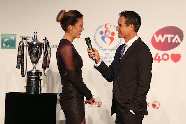 ISTANBUL, TURKEY - OCTOBER 20: Agnieszka Radwanska of Poland is interviewed by Master of Ceremonies Andrew Krasny during the draw ceremony for the WTA Championships at the Renaissance Polat Hotel on October 20, 2013 in Istanbul, Turkey. (Photo by Matthew Stockman/Getty Images)
