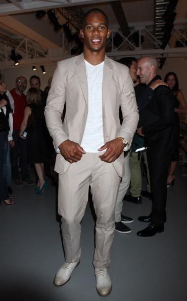 "<div class=""caption-credit""> Photo by: WireImage</div><div class=""caption-title"">International man of fashion</div>Cruz is also the only <i>Latino</i> included in 2012's Vanity Fair International Best Dressed List. Seen here at Milan's Menswear Fashion week, the football champ is showing a consistent awareness of fashion and mature sense of style."