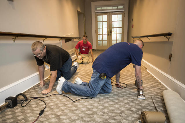 <p>Workmen install new carpet in the West Wing of the White House in Washington,, Friday, Aug. 11, 2017, as it undergoes renovations while President Donald Trump is spending time at his golf resort in New Jersey. (AP Photo/J. Scott Applewhite) </p>