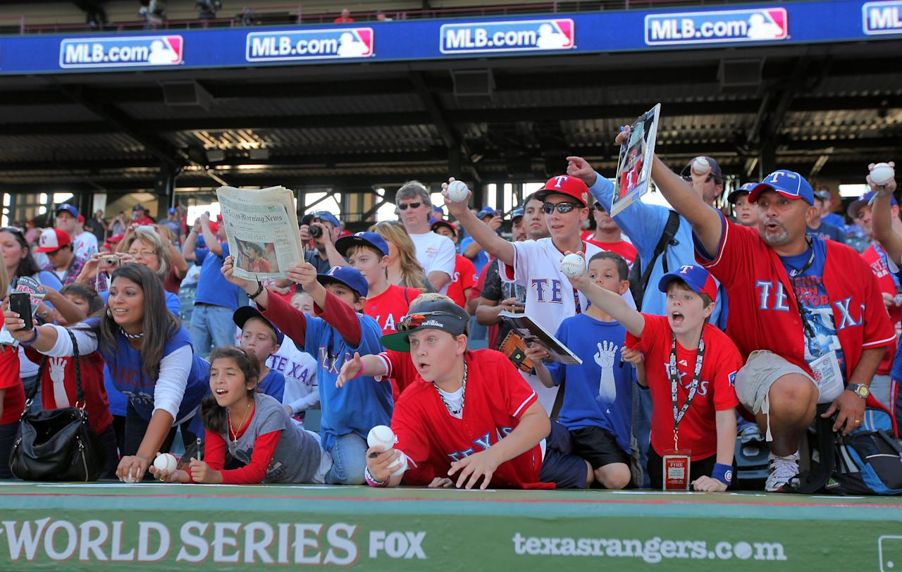 ARLINGTON, TX - OCTOBER 23: Fans call out for autographs during batting practice before Game Four of the MLB World Series between the St. Louis Cardinals and the Texas Rangers at Rangers Ballpark in Arlington on October 23, 2011 in Arlington, Texas.  (Photo by Doug Pensinger/Getty Images)