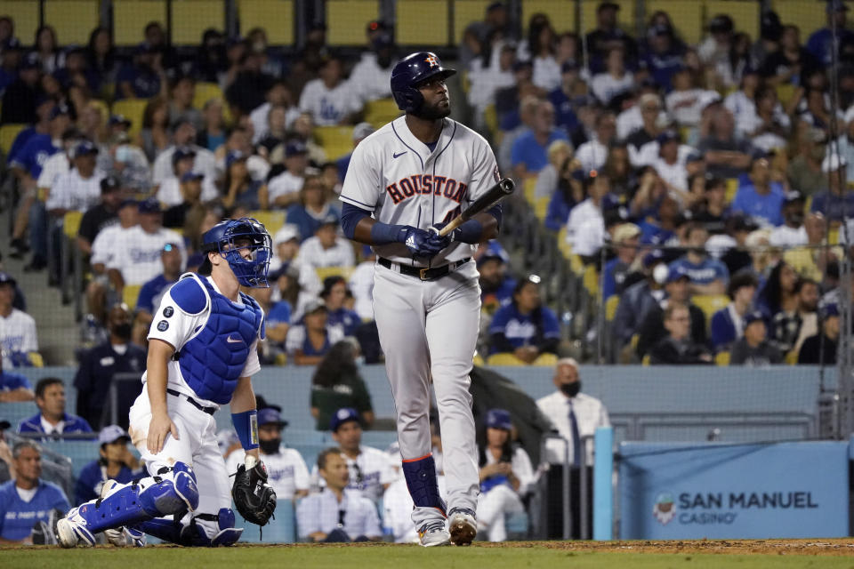 Houston Astros' Yordan Alvarez watches his two-run home run during the eighth inning of the team's baseball game against the Los Angeles Dodgers on Tuesday, Aug. 3, 2021, in Los Angeles. (AP Photo/Marcio Jose Sanchez)