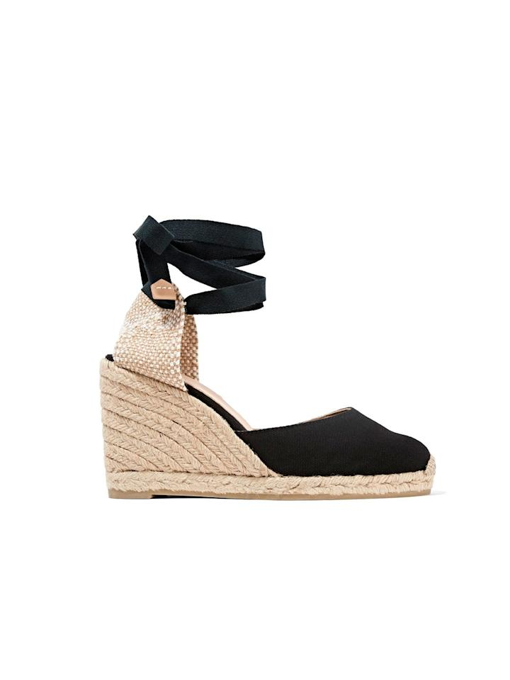 """<p>Crafted from durable black canvas and a jute wedge heel, these summer-ready espadrilles (worn by Meghan at Sydney's Bondi Beach) are the perfect out-of-office shoe.</p> <p><strong>To buy:</strong> $120; <a href=""""https://click.linksynergy.com/deeplink?id=93xLBvPhAeE&mid=24449&murl=https%3A%2F%2Fwww.net-a-porter.com%2Fus%2Fen%2Fproduct%2F822908&u1=RS%2CTheUltimateGuidetoMeghanMarkle%2527sShoeCollection%2Crsylvester805%2CSHO%2CIMA%2C633506%2C201907%2CI"""" target=""""_blank"""">net-a-porter.com</a>.</p>"""