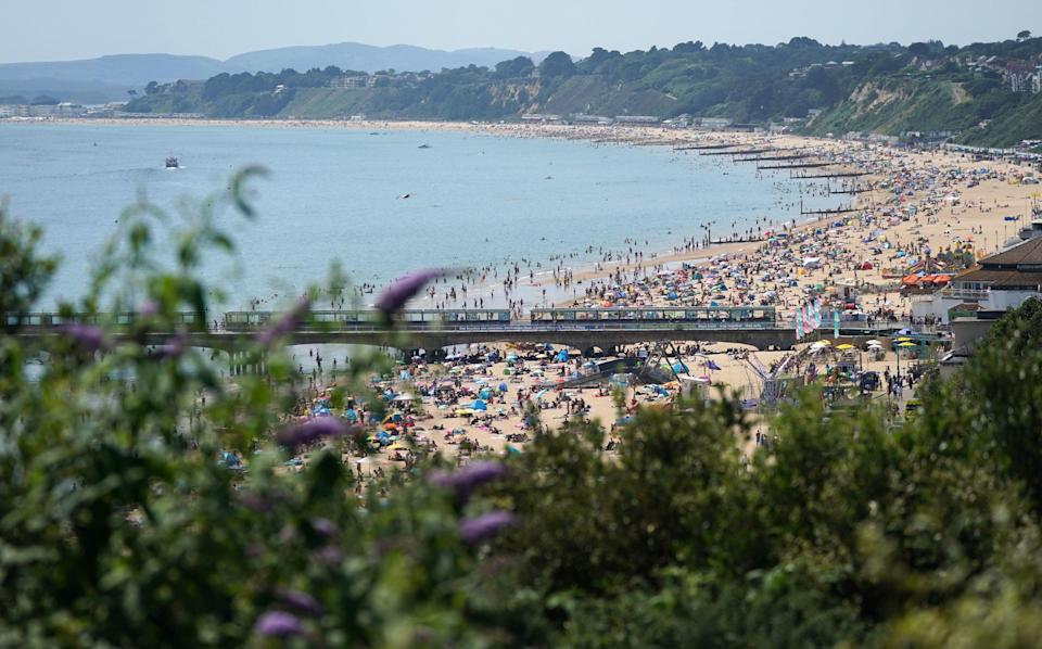 People enjoying the hot weather at Bournemouth beach on Tuesday (PA)