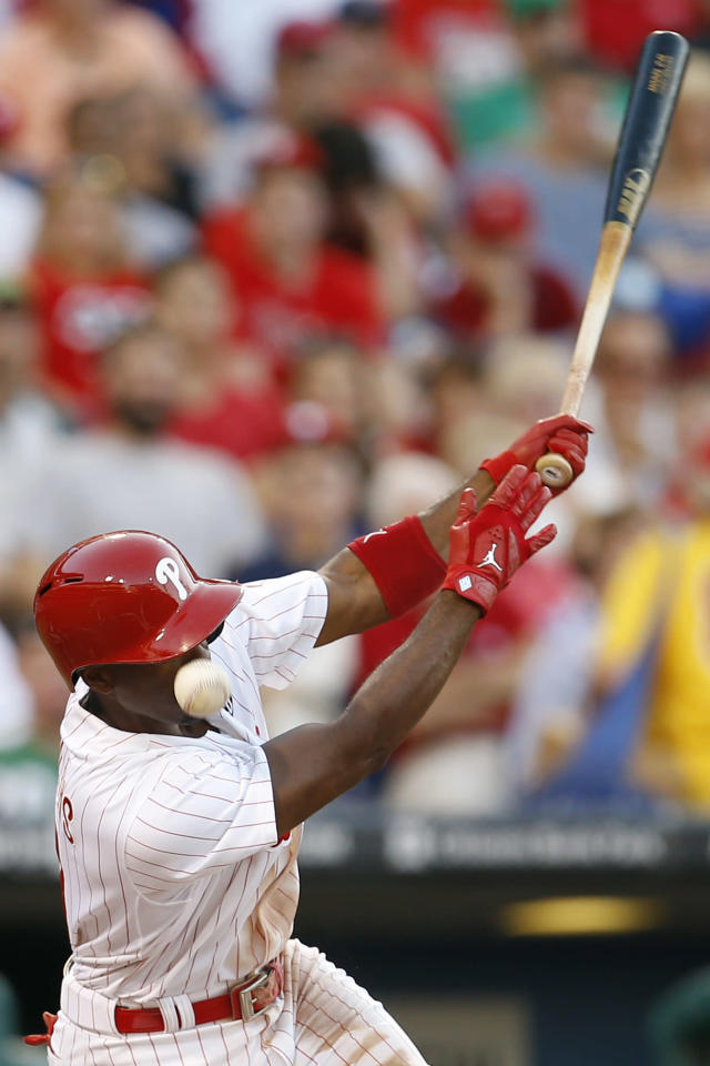 Philadelphia Phillies' Jimmy Rollins is hit in the face by a foul ball during the second inning of a baseball game against the Miami Marlins, Tuesday, June 24, 2014, in Philadelphia. (AP Photo/Matt Slocum)