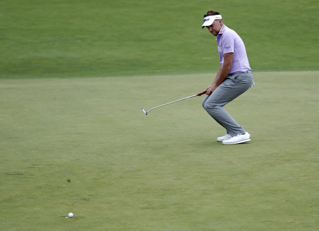 Ian Poulter was one back of Dustin Johnson, then finished triple bogey-bogey. Still, he's just five strokes back. (AP)