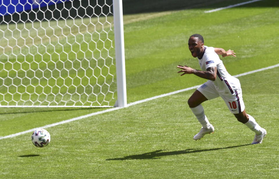 England's Raheem Sterling reacts after scoring his team's first goal during the Euro 2020 soccer championship group D match between England and Croatia at Wembley stadium in London, Sunday, June 13, 2021. (Justin Tallis/Pool via AP)