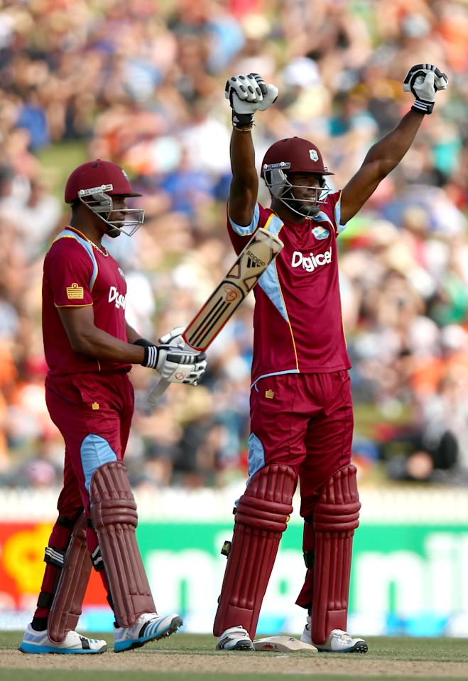 HAMILTON, NEW ZEALAND - JANUARY 08: Kirk Edwards of the West Indies (R) celebrates his century with  Dwayne Bravo (L) during game five of the One Day International Series between New Zealand and the West Indies at Seddon Park on January 8, 2014 in Hamilton, New Zealand.  (Photo by Phil Walter/Getty Images)