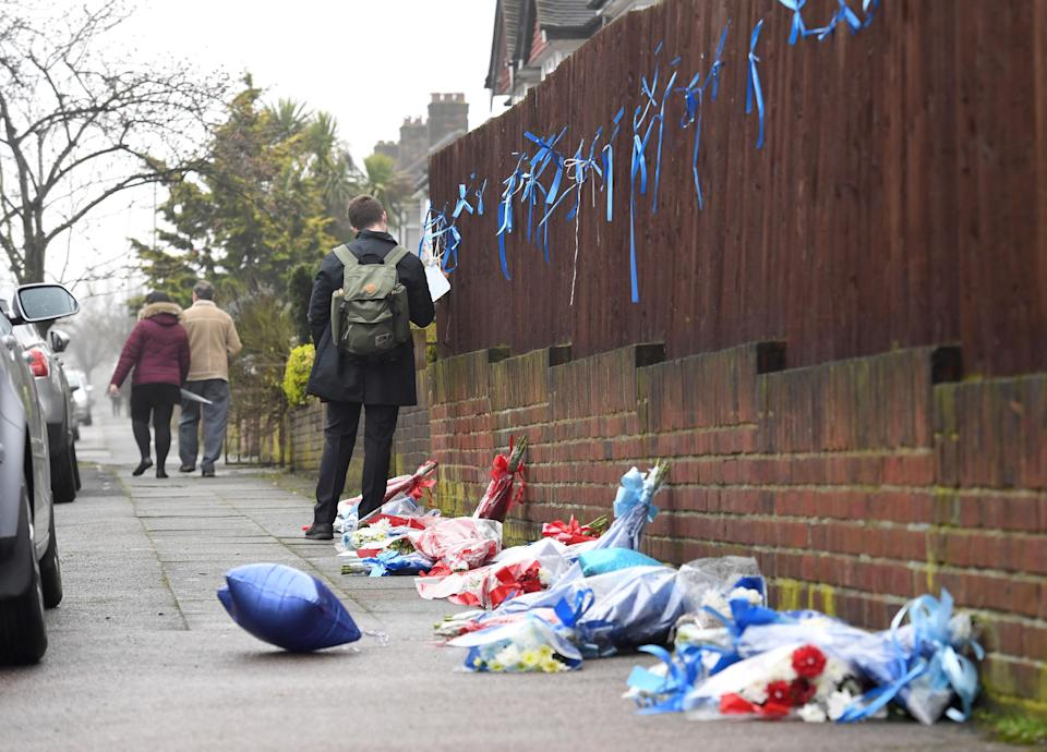 <em>'Shrine' – flowers, balloons and notes for Henry Vincent were torn down by angry vigilantes and neighbours (Picture: PA)</em>
