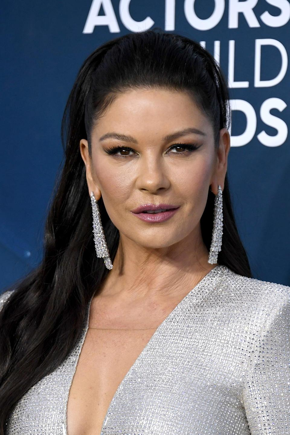 """<p>When not being fawned over by husband Gomez, Morticia can be found tending to her roses and acting as the glue that keeps her family together. Zeta-Jones, best known for her roles in <strong>Chicago</strong> and <strong>The Mask of Zorro</strong>, is set to take on the role previously played by Carolyn Jones on 1964's <strong>The Addams Family</strong>, Anjelica Huston in 1991's <strong>The Addams Family</strong> and <a href=""""https://www.popsugar.com/entertainment/addams-family-values-halloween-essay-47863092"""" class=""""link rapid-noclick-resp"""" rel=""""nofollow noopener"""" target=""""_blank"""" data-ylk=""""slk:1993's Addams Family Values"""">1993's <strong>Addams Family Values</strong></a>, and <a class=""""link rapid-noclick-resp"""" href=""""https://www.popsugar.com/Charlize-Theron"""" rel=""""nofollow noopener"""" target=""""_blank"""" data-ylk=""""slk:Charlize Theron"""">Charlize Theron</a> in the 2019 animated film <strong>The Addams Family</strong>.</p>"""