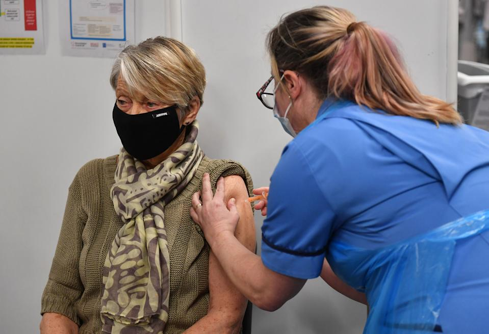 Rita Passey receives an injection of a Covid-19 vaccine at the NHS vaccine centre that has been set up at the Millennium Point centre in Birmingham. The centre is one of the seven mass vaccination centres now opened to the general public as the government continues to ramp up the vaccination programme against Covid-19.