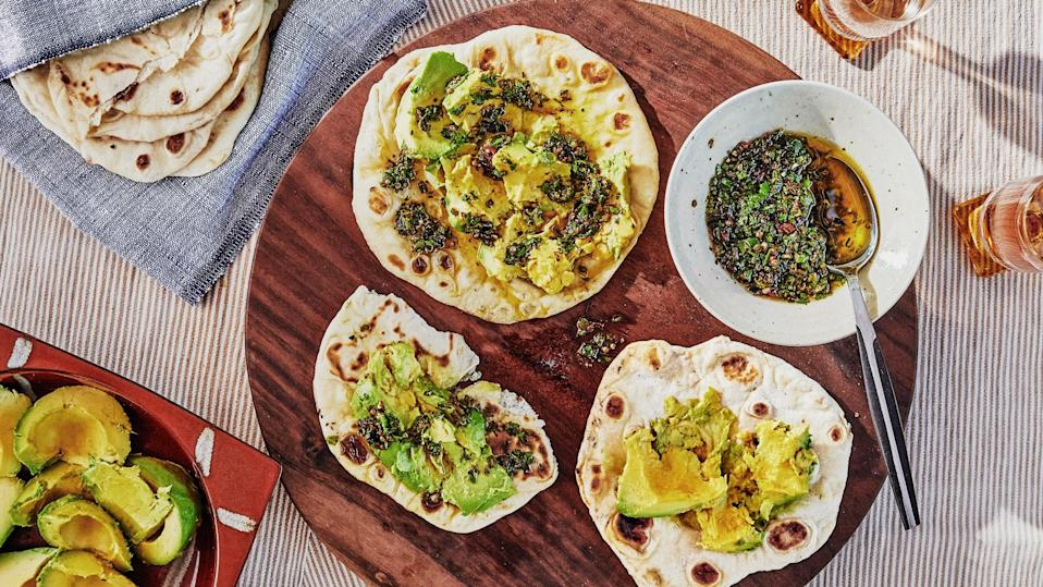 "Pillowy flatbread is an optimal canvas for buttery avocados and a spicy salsa, but it can also be a vehicle for all kinds of dips and spreads. This is obviously a riff on avocado toast, but it's 10x better because homemade flatbread beats toast any day. <a href=""https://www.bonappetit.com/recipe/flatbread-with-avocado-and-scallion-salsa?mbid=synd_yahoo_rss"" rel=""nofollow noopener"" target=""_blank"" data-ylk=""slk:See recipe."" class=""link rapid-noclick-resp"">See recipe.</a>"