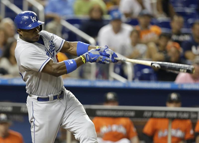 Los Angeles Dodgers' Yasiel Puig hits a solo home run in the eighth inning of a baseball game against the Miami Marlins, Tuesday, Aug. 20, 2013 in Miami. The Dodgers won 6-4. (AP Photo/Lynne Sladky)
