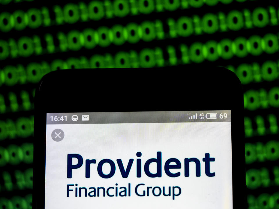 UKRAINE - 2019/03/19:  In this photo illustration, the Provident Financial Group plc company logo seen displayed on a smartphone. (Photo Illustration by Igor Golovniov/SOPA Images/LightRocket via Getty Images)