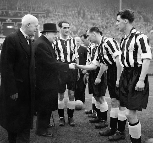 Winston Churchill is introduced to Jackie Milburn and the Newcastle team by captain Joe Harvey (PA)