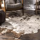 "<p>To be honest, I didn't exactly notice that the<span>Vaquero Macchiato Faux Cowhide Rug </span> ($109) came with gold-fleck accents when I hit the ""order"" button, but I've come to love the added detail. My main concern was that they would peel off the second I vacuumed, but they've held strong for five months and counting.</p>"